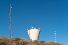 Water reservoir and telecommunications towers in the centre of W. A water reservoir and telecommunications towers in the centre of Windhoek, the capital city of Royalty Free Stock Photo