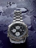 Water resistant watch. Water resistant high tech watch splashed with water drops royalty free stock photos