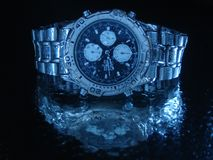 Water resistant watch. Water resistant high tech watch splashed with water drops royalty free stock photo