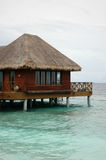 Water Resort. A resort house over water on stilts stock photography