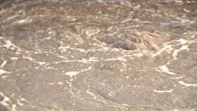 Water ripple, polluted water, polluted river. Dirty foam ripple. Static closeup. Water ripple, polluted water, polluted river. Ripples on the water with dirty stock footage