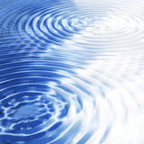 Water ripples. Blue and white water ripples background Stock Photography
