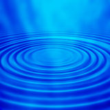Water ripples. In blue background Royalty Free Stock Photography