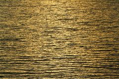 Water ripples and sunrays reflections. Close up Water ripples and sunrays reflections royalty free stock photo