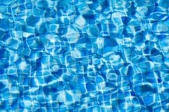 Water ripples texture in swimming pool. Blue water ripples texture in swimming pool Royalty Free Stock Photo