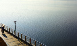 Water; river; sea; lake; bridge; sunset; the breeze; railings; s Royalty Free Stock Photos