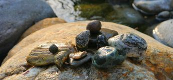Water river stones flow power rest Royalty Free Stock Images