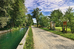 Water and road in the canavese countryside stock photo