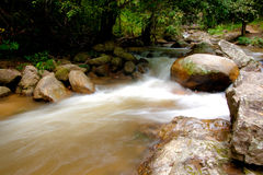 Water and rocks. Water flowing over rocks in a lake Stock Photography