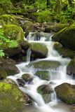 Water and rocks. And waterfall Stock Image