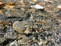 Water Rocks 3. Clear water running over colourful rocks and pebbles in a stream stock image