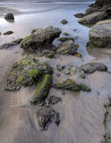 Water and rocks on the beach. Royalty Free Stock Photos