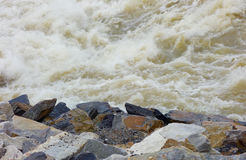 Water rocks danger hazardous uncertainty turmoil Stock Images