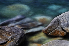 Water and rocks. Rocks lining the coastline af lake tahoe Stock Photo