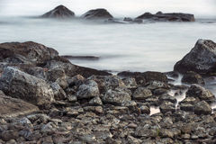 Water and rocks during low tide Royalty Free Stock Images