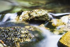 Water and rocks. On the shore of a river Royalty Free Stock Images