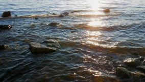 Water and rocks. Waves on the shore of the Gulf of Finland stock video