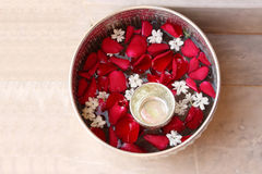 Water with rose petal and jasmine in silver bowl Royalty Free Stock Photos