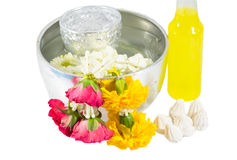 Water with roses and vivid flower corolla in bowl and soft-prepared chalk for Songkran festival, Thailand. Isolated Royalty Free Stock Image