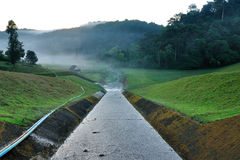 Water route from reservoir to down hill for people use. Royalty Free Stock Photos