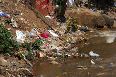 Water rubbish pollution with cloth and other floating stuffs, Tamil Nadu, India. Stock Photo
