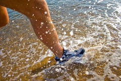 Water Run. Photograph taken on beach of Greece during a run. Taken from side to highlight the water impact Stock Image