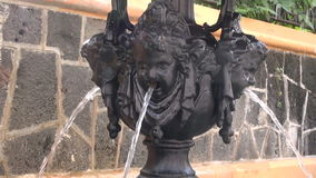 Water running through antique fountain stock footage