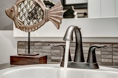 Runing Water from High End Bathroom Faucet. The Water is On and Running from this Bathroom Faucet Stock Photos