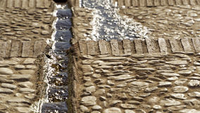 Water running down a Moor gutter in the streets of Frigiliana Stock Images