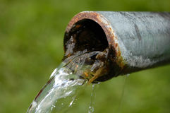 Water running from pipe natural fresh clean mountain spring Royalty Free Stock Photography