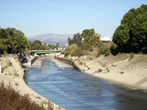 Water runs along Cement Water Canel in LA Stock Photo