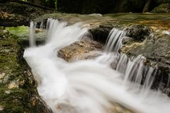 Water runs down a small stream, long exposure royalty free stock images