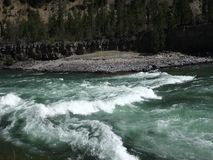 Mountain run-off in the springtime. Water rushing through a canyon in the rockies stock video footage