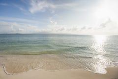 Water's edge on beach, Koh Pha Ngan, Thailand Stock Images