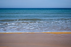 Water`s edge on sandy beach Royalty Free Stock Photo