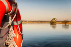 Water safety bouy on boat in Yellow Water billabong at dawn, Nor. Focus on water safety. Yellow Water billabong in golden dawn light, Northern Territories Royalty Free Stock Photo