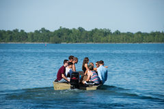 Water safety. Group of students overloading a motorboat, drinking alcohol and not wearing life jackets at Grosse Ile, Detroit on June 02, 2014 Royalty Free Stock Images