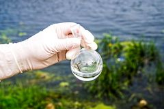 A water sample from the river. Water intake. Water abstraction. stock image