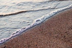 Water and sand Stock Photography