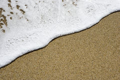 Water and sand beach detail Royalty Free Stock Images