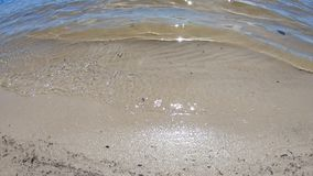Water and sand. Lake water and sand. Close-up water stock video