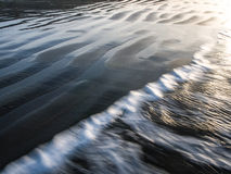 Water and Sand Waves Royalty Free Stock Images