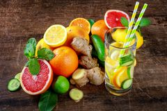 Water Sassy with lemon, grapefruit, orange, mint, cucumber and g Stock Images