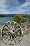 Water Scene in New Zealand. With an old horse and cart wheel Stock Photo