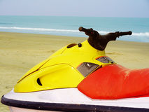 Water Scooter. A colorful water scooter on the beach Stock Photo