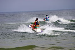 Water Scooters or jet skis. People riding water scooters or jet skis Royalty Free Stock Image