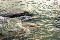 Water sea movement. Sea water moving around the rocks Stock Image