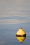 Water sea  with yellow beacon Royalty Free Stock Photo