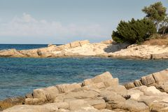 Water and seaside rocks in Greece Stock Images