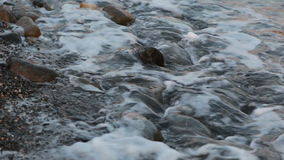 Water at seaside with stone stock video footage